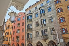 Colorful house facades decorated with paintings and located in the historic center on street Herzog Friedrich Strasse Stock Photos