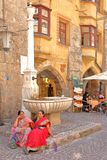 Indian tourists relaxing in front of a fountain located in the historic center on street Herzog Friedrich Strasse Royalty Free Stock Images