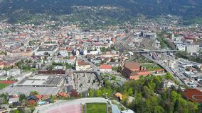 Innsbruck, Austria. The stadium of the ski jumping hill tower and the track. In the background the city of Innsbruck. Spring time stock video footage