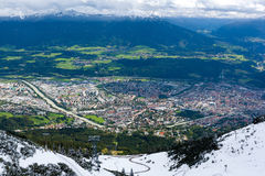 Innsbruck. City of Innsbruck, Austria from the top of a mountain. Snowcapped mountains in the distance Stock Image