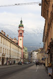 Innsbruck cityscape with church spire and snow mountains Stock Photography