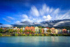 Innsbruck houses at morning. Long exposure photo of houses in Innsbruck at the river Inn. Brands, shop names and people have been removed Stock Images