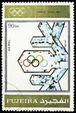 Innsbruck 1964, Winter Olympics 1924-1972, Advertising posters serie, circa 1972. MOSCOW, RUSSIA - MARCH 23, 2019: Postage stamp printed in United Arab Emirates stock images