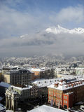 Innsbruck in winter with snow on rooftops and view on the mountains, 2012 Royalty Free Stock Images