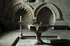 Inom en kyrka - dopfunt Royaltyfria Foton