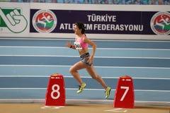 Inomhus lopp för friidrottrekordförsök Royaltyfria Foton