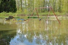 Inondazione della primavera del campo da giuoco Immagini Stock Libere da Diritti