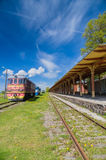 Inoperative railway station in Haapsalu, Estonia. HAAPSALU, ESTONIA - MAY 24: Retro locomotive trains and unoperative station in Railway and Communications royalty free stock image