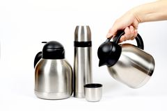 Inox metal thermos. Modern metal thermos with and without handle Stock Images