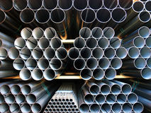 Inox Steel pipes stacked on pile. Group of inox steel pipes stacked inside a transport trailer Stock Photography