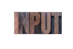 Input. The word 'input' in old ink-stained wood type Royalty Free Stock Photography