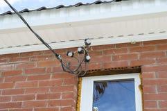 Input dei cavi elettrici Fotografia Stock