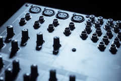 Input plugs on mixer. Close up shot of some input plugs on a audio mixer Royalty Free Stock Images