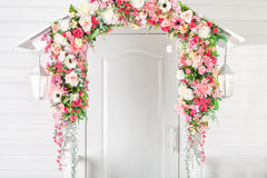 Input white door, porch and street lights . Flower arch. Spring. Input white door, porch and street lights . Flower arch. Provence style Royalty Free Stock Photography
