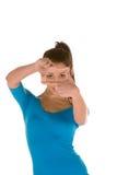 Inquadramento del fronte di una donna giovane Immagini Stock