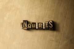 INQUIRIES - close-up of grungy vintage typeset word on metal backdrop Stock Photo