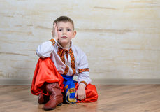 Inquiring boy with traditional folk costume Stock Images