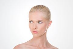 Inquiring nordic girl. Blond woman watching something on her right Royalty Free Stock Images