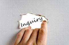 Inquiry concept. Hand and text on the cardboard background Inquiry Royalty Free Stock Photography