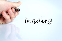 Inquiry concept. Pen in the hand  over white background Inquiry concept Stock Photography