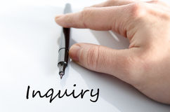 Inquiry concept. Pen in the hand  over white background Inquiry concept Stock Images