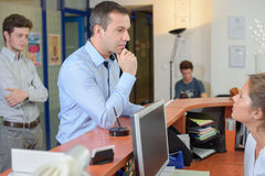 Inquiry in front desk. Inquiry in the front desk Royalty Free Stock Photo