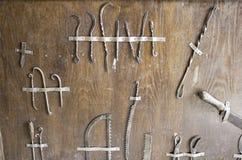 Inquisición de los instrumentos médicos Foto de archivo