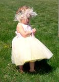Inquisitive. A darling toddler plays in an open field making her own discoveries Royalty Free Stock Photos