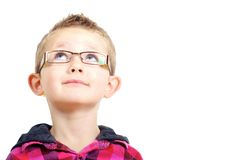 Inquisitive boy. Looking upwards shot against a white background Royalty Free Stock Images