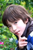 Inquisitive Boy. Portait of a boy trying to get your attention Royalty Free Stock Images