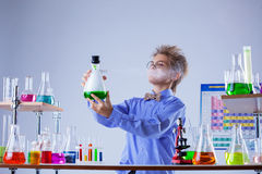 Inquisitive boy looking for evaporation of reagent Royalty Free Stock Photos