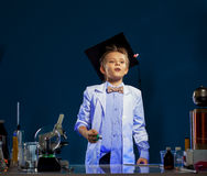 Inquisitive boy watching result of experiment Royalty Free Stock Photography