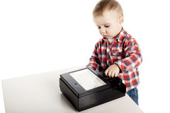 Inquisitive little boy turns switches on device Royalty Free Stock Photos
