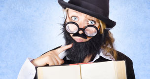 Inquisitive scientist holding open theory book Stock Photo