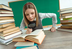 Inquisitive teenage girl reading a book Royalty Free Stock Image