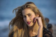 Inquisitive young woman with glance. An inquisitive blonde young woman with glance stock images
