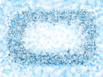 Inrama frostiga snowflakes Arkivfoto