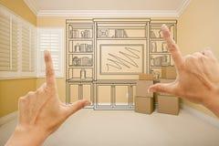Inrama händer i tomt rum med hyllateckningen på väggen arkivfoton