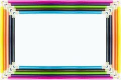 Inrama mångfärgade blyertspennor för formen som isoleras på vit bakgrund Royaltyfri Fotografi