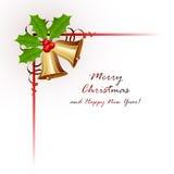 Inrama med julklockor och järnekbäret Arkivfoto