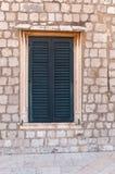Inramat forntida fönster med slutare Royaltyfria Bilder