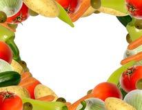 inramnin den hjärta formade grönsaken Arkivbild
