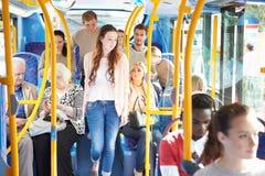 Inre av bussen med passagerare Royaltyfria Bilder
