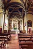 Inre av Chiesa di Santa Maria i portik a Fontegiusta är romersk - katolska kyrkan i Siena italy royaltyfri foto