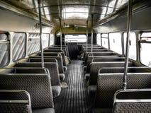 Inre av den gamla bussen, tappning och retro bakgrund Royaltyfri Bild