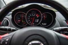 Inre av den röda sportbilen Mazda RX-8 i natur Fotografering för Bildbyråer