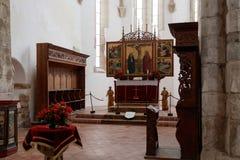 Inre av den stärkte kyrkliga Prejmeren i den Prejmer staden i Rumänien Royaltyfria Bilder
