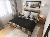 Inre av det moderna sovrummet i huset Arkivfoto