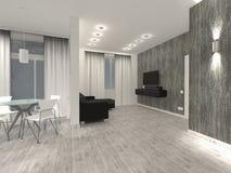 Inre av lägenheten är en ljus studio med mörkt möblemang framförande arkivfoto