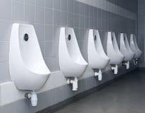 inre modern toalettradpissoar Arkivfoto